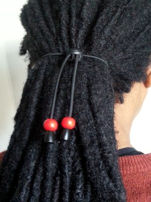 Red bead hair tie displayed