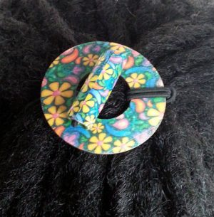 Flowers Wood Circle Hair Tie displayed