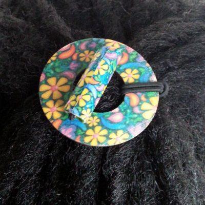 Flowers Wood Circle Hair Tie displayed