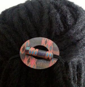 Kente Wood Hair Tie Circle displayed