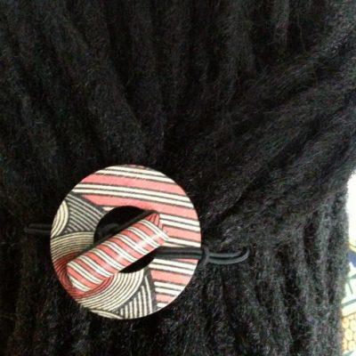 Red Geo Circle Hiar tie displayed