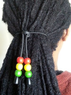 red gold green hair tie displayed